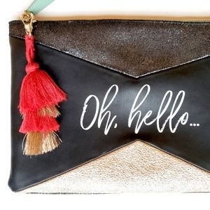 UO leather blend clutch bag w/tassel NWOT